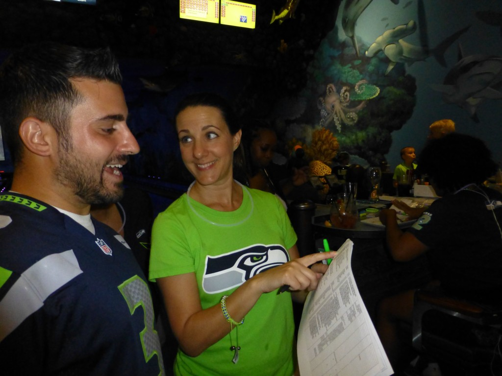 Jenna discusses Seattle Seahawks in Austin Texas Booster Club Membership with a fan.