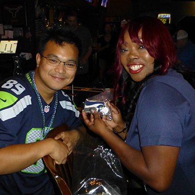Latrice hooking up fans with Seahawks cookies.