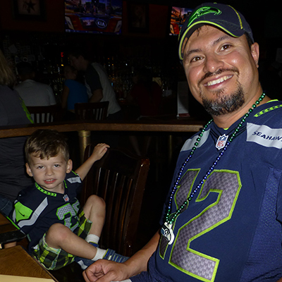 Another cute little fan in his Seahawks jersey.